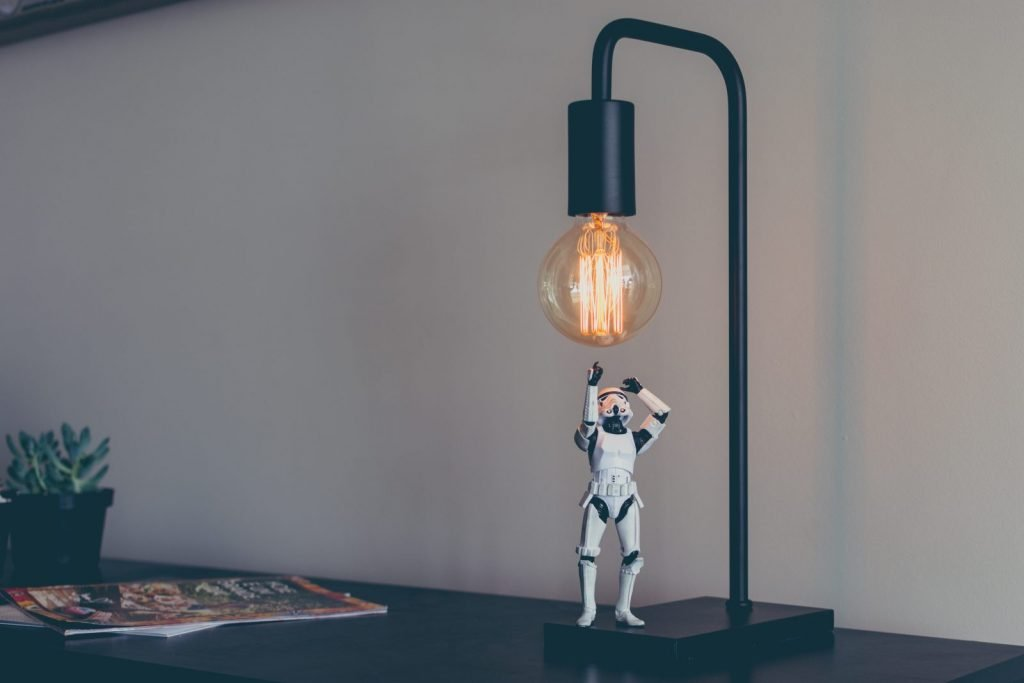Storm trooper under an Edison light bulb. The true pressures of creative guilt. All lights and heat on you!